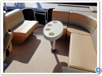 L shape bench seating in back and small couch behind the captain's chair