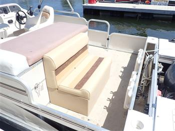 A comfortable captain's chair, L-shape seating in the middle, two benches in front as well as two fishing chairs at the back.