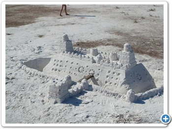 Build sand castles in the soft white sand.
